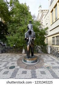 Prague, Czech Republic - November 01, 2018 Statue of Franz Kafka by artist Jaroslav Róna. Statue depicts Franz Kafka riding on the shoulders of a headless figure