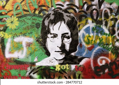 PRAGUE, CZECH REPUBLIC - NOVEMBER 11: The Lennon Wall since the 1980s is filled with John Lennon-inspired graffiti and pieces of lyrics from Beatles songs on Nov 11, 2014 in Prague, Czech