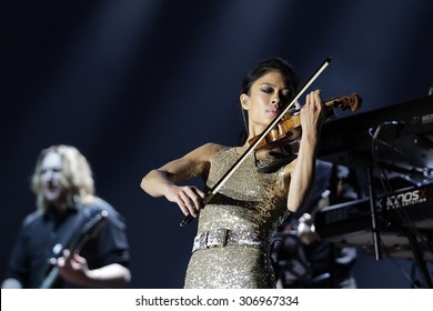 PRAGUE, CZECH REPUBLIC - NOVEMBER 11, 2014: British violinist Vanessa Mae performs live on stage during a concert at 02 arena on November 11, 2014 in Prague, Czech Republic.