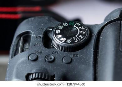 Prague, Czech republic - November 14, 2018: Mode selection dial of used Canon EOS 750D DSLR camera in black silicone protective case