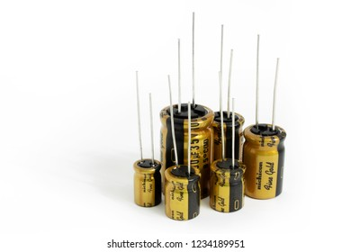 Prague, CZECH REPUBLIC - NOVEMBER 17, 2018: High quality audio grade Japanese aluminium electrolytic capacitors Nichicon Fine Gold laid on white background