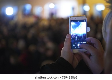 Prague, Czech Republic - November  17, 2017: People taking photos with cell phone during celebrations of the Velvet Revolution commemorating the events of 17 November 1989 in Prague, Czech Republic