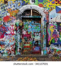 PRAGUE, CZECH REPUBLIC - NOVEMBER 18:The Lennon Wall since the 1980 filled with graffiti Nov 18, 2015 Prague, Czech Republic.