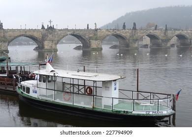 PRAGUE, CZECH REPUBLIC - NOVEMBER 28, 2012: Prague is  and the capital of the Czech Republic is a traditional European cultural center. Charles bridge - medieval bridge in Prague over the river Vltava