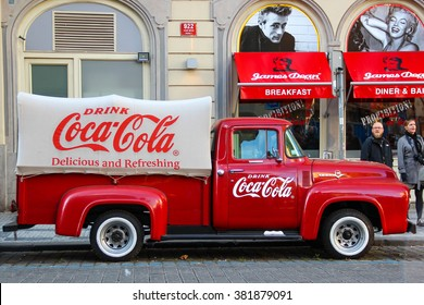 PRAGUE, CZECH REPUBLIC - Oct 23 2015: An old renovated red Ford vintage Coca cola truck (pickup) in a parking lot., Czech Republic, on Oct 23, 2015.