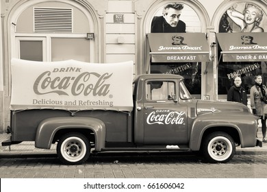 PRAGUE, CZECH REPUBLIC - Oct 23 2015: An old renovated red Ford f-100 vintage Coca cola truck (pickup) in a parking lot., sepia
