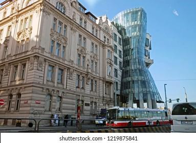 PRAGUE, CZECH REPUBLIC - OCTOBER 04, 2018:  Dancing house in the style of deconstruction on the Vltava  Embankment in Prague