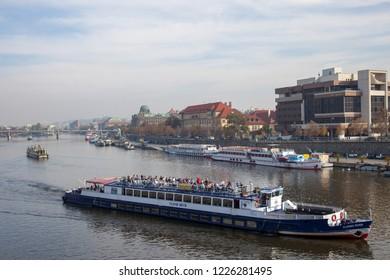 PRAGUE, CZECH REPUBLIC - OCTOBER 09, 2018: River walks on the Vltava River. View from Chekhov Bridge