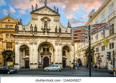 Prague, Czech Republic - October 1 2017: Traffic and pedestrians pass by the St. Salvator Church, one of two churches in the Klementinum, in Old Town, Prague, Czech Republic