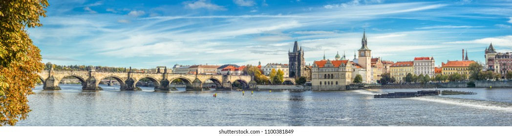 Prague, Czech Republic - October 10, 2017: Panoramic autumn river view on Vltava river, Charles Bridge and  Prague Castle , Czech Republic. Prague old town. Panorama.