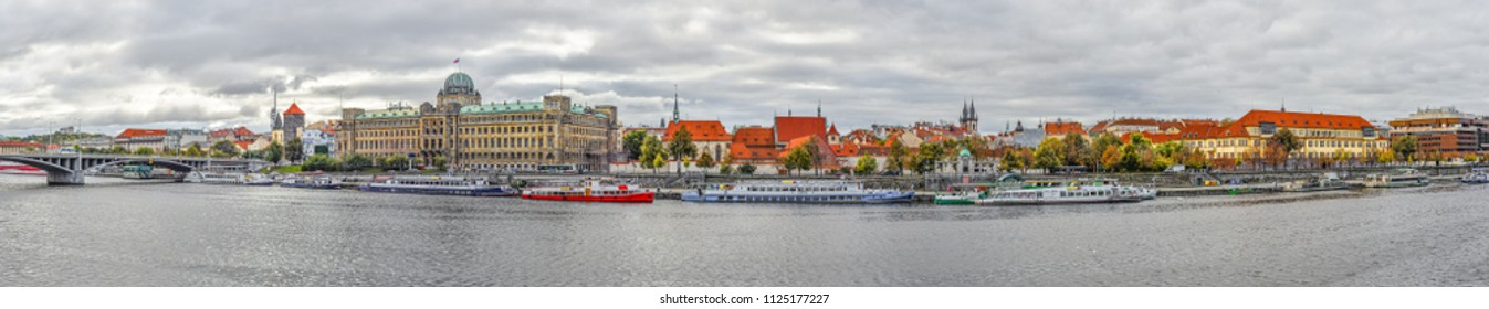 Prague, Czech Republic - October 10, 2017: Beautiful panoramic view on Vltava river, Ministry of Transportation of the Czech Republic and old  Tyn Church.  Panorama of Prague.