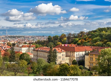 Prague, Czech Republic - October 10, 2017: Bright and beautiful autumn view on Prague Castle, Old town and city center with old red roofs and dramatic sky, Prague, Czech Republic