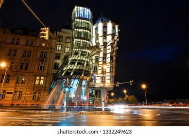Prague, Czech Republic - October 11, 2017: Night view on modern building of Dancing House or Fred and Ginger. Nationale-Nederlanden building on the (Ras?n Embankment) in Prague, Czech Republic