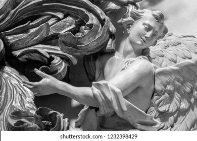 PRAGUE, CZECH REPUBLIC - OCTOBER 12, 2018: The carved polychrome baroque statue of angel from the side altar in St. Francis of Assisi church by  M. V. Jäckel a J. K. Liška. (17. - 18. cent.).