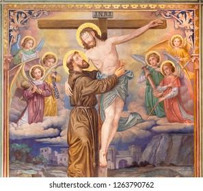 PRAGUE, CZECH REPUBLIC - OCTOBER 12, 2018: The symbolic idilic painting of St. Francis of Assisi and crucificted Jesus in church Bazilika svatého Petra a Pavla na Vyšehrade.