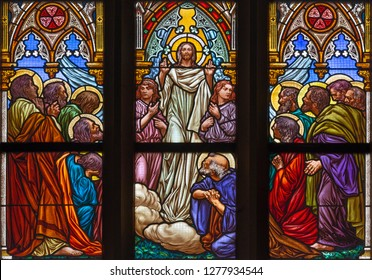 PRAGUE, CZECH REPUBLIC - OCTOBER 12, 2018: The Ascension of the Lord on the windowpane in church Bazilika svatého Petra a Pavla na Vyšehrade designed by František Sequens end. of 19. cent.