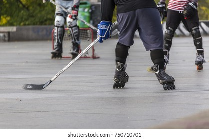 PRAGUE, CZECH REPUBLIC - OCTOBER 12, 2017 - Low angle view of people playing street hockey in Letna Park in Prague, Czech Republic.