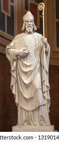 PRAGUE, CZECH REPUBLIC - OCTOBER 13, 2018: The marble statue of St. Vojtěch (Adalbert) in church kostel Svatého Václava by artwork Čeněk Vosmík  made by Luisi in Carrara (end of 19. cent).