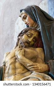 PRAGUE, CZECH REPUBLIC - OCTOBER 14, 2018:  The detail of the statue of Pieta in church of St. Egidius (Jiljí) by unknown artist.