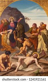 PRAGUE, CZECH REPUBLIC - OCTOBER 15, 2018: The painting Jesus is nailed to the cross (cross way station) in church Bazilika svatého Petra a Pavla na Vyšehrade by František Čermák (1822 - 1884).