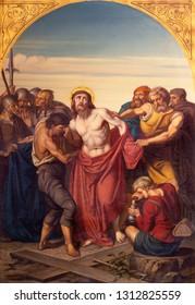 PRAGUE, CZECH REPUBLIC - OCTOBER 15, 2018: The painting Jesus clothes are taken away (cross way station) in church Bazilika svatého Petra a Pavla na Vyšehrade by František Čermák (1822 - 1884).