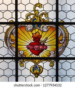 PRAGUE, CZECH REPUBLIC - OCTOBER 16, 2018: The baroque heart of Virgin Mary in the stained glass in church kostel Svatého Havla by unknown baroque artist.