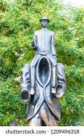 PRAGUE, CZECH REPUBLIC - OCTOBER 17, 2018: Franz Kafka Memorial. Unusual sculpture in Jewish Quarter, Prague, Czech Republic