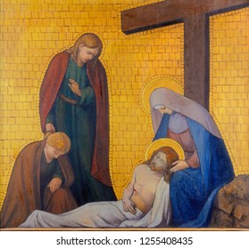 PRAGUE, CZECH REPUBLIC - OCTOBER 17, 2018: The painting of Deposition or Pieta (cross way station) in the church kostel Svatého Cyrila Metodeje by  S. G. Rudl (1935).