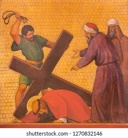PRAGUE, CZECH REPUBLIC - OCTOBER 17, 2018: The painting Jesus fall under the cross in the church kostel Svatého Cyrila Metodeje by  S. G. Rudl (1935).