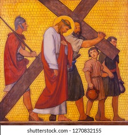 PRAGUE, CZECH REPUBLIC - OCTOBER 17, 2018: The painting Simon of Cyrene helps Jesus carry the cross in the church kostel Svatého Cyrila Metodeje by  S. G. Rudl (1935).
