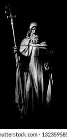 PRAGUE, CZECH REPUBLIC - OCTOBER 17, 2018: The carved statue of Saint Cyril in church Svatého Cyrila Metodeje by Bretislav Kafka (1891 - 1967).