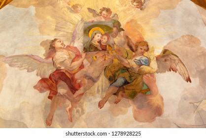 PRAGUE, CZECH REPUBLIC - OCTOBER 18, 2018: The fresco angels with the image of Madonna in church Kostel Svaté Kateřiny Alexandrijské by Václav Vavřinec Reiner (1689 - 1743).
