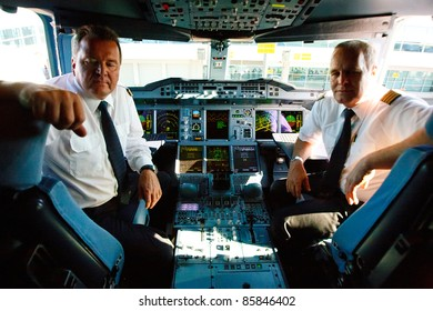 PRAGUE, CZECH REPUBLIC - OCTOBER 2: first-ever arrival of the largest passenger aircraft today, Airbus A380, to the Airport Prague on October 2, 2011. Cockpit with captains of the flight.