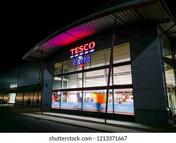 Prague, Czech Republic October 20, 2018 - Tesco Extra facade of a shopping center in Zlicin at night