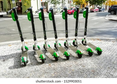 Prague, Czech republic - october 2019: group of the Lime bikes/scooters parked on the street of the Karlin district