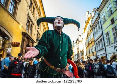 PRAGUE, CZECH REPUBLIC - OCTOBER 21, 2018: Street artist in old costume of Jester.