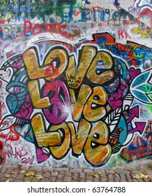PRAGUE, CZECH REPUBLIC- OCTOBER 21:The Lennon Wall since the 1980s filled with John Lennon-inspired graffiti and pieces of lyrics from Beatles songs on October 21, 2010 in Prague, Czech Republic