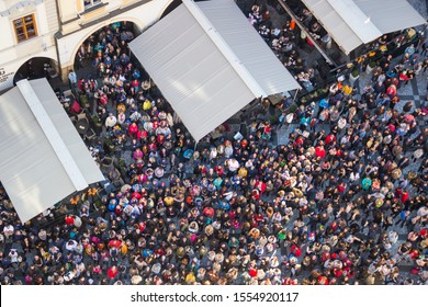 PRAGUE, CZECH REPUBLIC - OCTOBER 26, 2019: Crowd of people on Old Town Square (Staromestske Namesti) looking up for astronomical clock on Old Town Hall