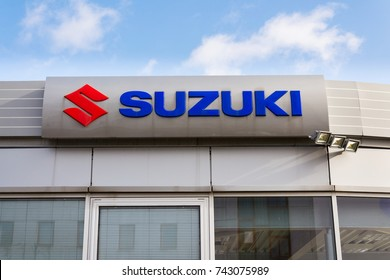 PRAGUE, CZECH REPUBLIC - OCTOBER 27: Suzuki Motor corporation logo on dealership building on October 27, 2017 in Prague. Japanese carmaker is betting on hybrids for its most important market - India.
