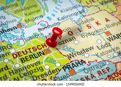 PRAGUE, CZECH REPUBLIC - OCTOBER 28, 2019: Red thumbtack in a map. Pushpin pointing at Berlin city in Germany.