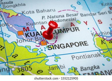 PRAGUE, CZECH REPUBLIC - OCTOBER 28, 2019: Red thumbtack in a map. Pushpin pointing at Singapore city in Singapore.