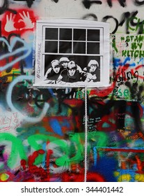 PRAGUE, CZECH REPUBLIC - OCTOBER 3: The Lennon Wall since the 1980s is filled with John Lennon-inspired graffiti and pieces of lyrics from Beatles songs on October 3, 2015 in Prague, Czech Republic