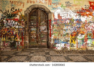 PRAGUE, CZECH REPUBLIC - OCTOBER 7, 2010: Colorful graffiti on the Lennon Wall in Prague on October 7, 2010. The wall, focused on peace, is a landmark of the Velvet Revolution in the 1980s.