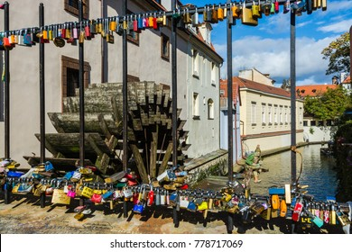 Prague, Czech Republic - October 7, 2017: Love locks on a fence by old water mill on Kampa Island in Prague, Czech Republic