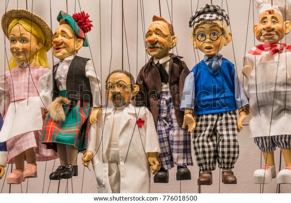 Prague, Czech Republic - October 7, 2017: Carved wooden marionette puppets on strings ready for performing in theaters.