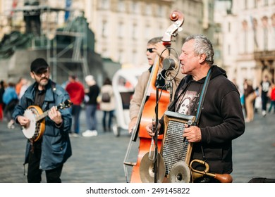 PRAGUE, CZECH REPUBLIC - OCTOBER 8, 2014: Street Busker performing jazz songs at the Old Town Square in Prague. Busking is legal form of earning money on Prague Streets.