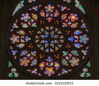 Prague, Czech Republic - October 9, 2017: Colorful religious stained glass rose window, St. Vitus Cathedral.