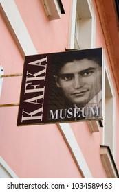 Prague, Czech Republic - October 9, 2017: Name Sign outside the Kafka Museum with a Franz Kafka portrait