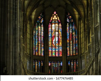 Prague / Czech Republic - October 9, 2015: Colorful religious stained glass window inside St. Vitus Cathedral.