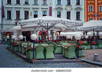 PRAGUE, CZECH REPUBLIC - Outdoor restaurant on cobblestone square in old town of Prague - largest city and capital of Bohemia whose historic centre included in the UNESCO list of World Heritage Sites.